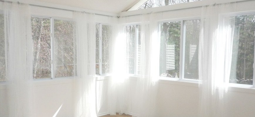 Hanging Curtains in Sunroom